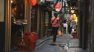 Stock Video Footage of Narrow alley with restaurants and people in Tokyo