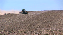 Tractor Plowing a Field in Eastern Washington - stock footage