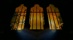 Time-lapse clouds flowing past church windows, with searchlight overlay - stock footage