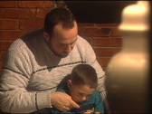 Stock Video Footage of Father and Son Reading 129