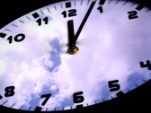 Stock Video Footage of Clock in time-lapse loop with fast moving clouds in the background