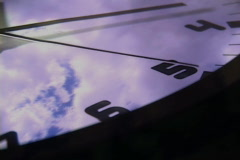 Fast moving clouds and clock in time-lapse (mirror effect) Stock Footage