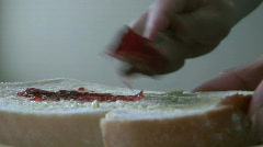 Jam Being Spread on a Slice of Bread Stock Footage