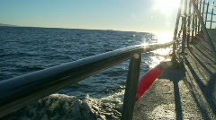View over Boat side - Heading out to sea, wake Stock Footage