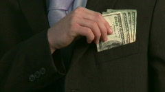 Buinessman with Dollars in Pocket Stock Footage