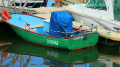 Green boat in harbor Stock Footage
