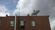 Stock Video Footage of Satellite dish on rooftop. Timelapse.