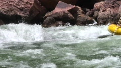 Beautiful shot of paddle boat entering rapids in Grand Canyon on Colorado River Stock Footage