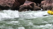 Stock Video Footage of beautiful shot of paddle boat entering rapids in Grand Canyon on Colorado River