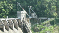 The top of a spillway of a dam in the mountains. Stock Footage