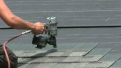 Man Doing A Roofing Job Stock Footage
