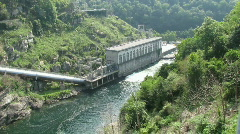 Zoom into the Hydro power plant of a dam Stock Footage
