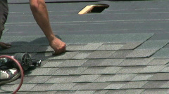Laying Shingles On A Roof Stock Footage