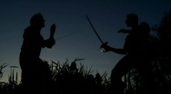 Stock Video Footage of men at sunset fighting with swords