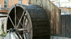 Water wheel with buildings P HD 1978 Stock Footage