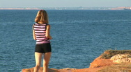 Stock Video Footage of Girl plays sports on seacoast. She runs. Escapes from a videocamera