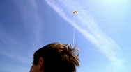 Stock Video Footage of boy playing with kite over blue sky