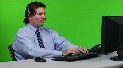 Young business man on headset - dolly shot Stock Footage