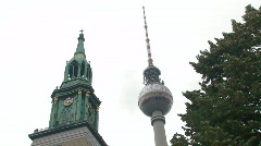 A church and TV tower in Berlin. - stock footage