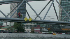 Cyclists on a bridge in Amsterdam Stock Footage