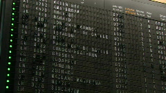 Airport flight departure timetable showing scheduled flights Stock Footage