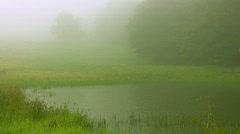 Rain on misty mountain lake Stock Footage