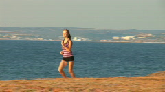 Girl runs against the sea! It the sportswoman. 1 Stock Footage