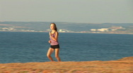 Stock Video Footage of Girl runs against the sea! It the sportswoman. 1