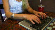 Woman uses Laptop Computer at Cafe Stock Footage