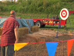 STATE FAIR AX THROWING BULLS EYE LARGE MAN Stock Footage