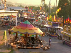 SUNSET COUNTY FAIR MIDWAY RIDES Stock Footage