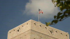 Downtown building and flag Stock Footage