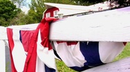 FARM HOUSE WHITE FENCE WITH FLAG DRAPPED  Stock Footage