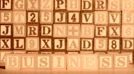 Stock Video Footage of Alphabet blocks spell PROFIT sepia - HD