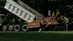 Machine and workers laying blacktop on road.  With audio. Stock Footage