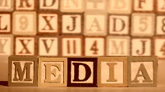 Alphabet blocks spell out MEDIA sepia - HD Stock Footage