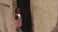 Masai child in doorstep Stock Footage