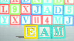 Wooden building blocks TEAM blocks background - HD  Stock Footage