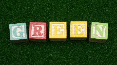 Building blocks GREEN on grass stop motion - HD  Stock Footage