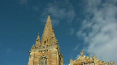 Stock Video Footage of Timelapse of clouds running above anglican church spire