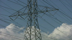 Stock Video Footage of Electrical pylon detail. Timelapse clouds.