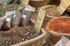 Spice table at market pan right Stock Footage