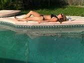 Beautiful Blonde in a Black Bikini Poolside-8 Stock Footage