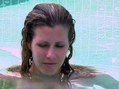 Stock Video Footage of Beautiful Blonde in a Swimming Pool (close-up)