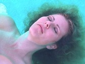 Beautiful Blonde Floating in a Pool-2 (slow motion) Stock Footage