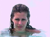Stock Video Footage of Beautiful Blonde in a Swimming Pool with Fog