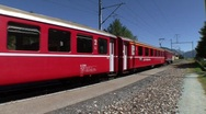 Stock Video Footage of Red Swiss Train Departing