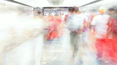 Timelapse video of shopping crowd in tunnel - stock footage