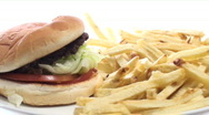 Burger and fries rotating is slow motion - HD  Stock Footage