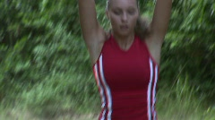 HD1080i Young attractive athletic woman jogging in the black forest Stock Footage